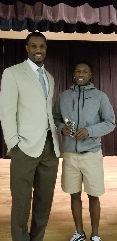 Coach Lewis and Newcomer of the Year Isaiah Lawson